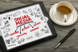 social media concept diagram hand drawing on tablet pc